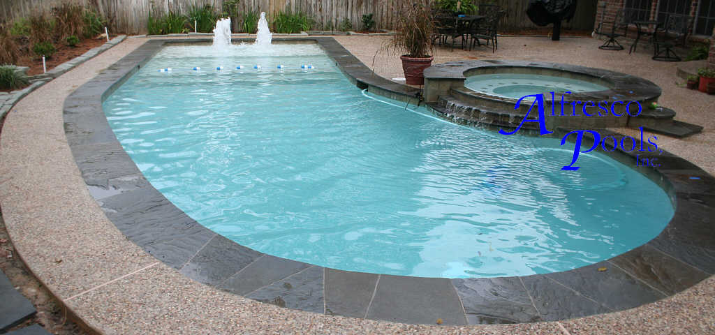 Pool with flagship spa 2 3 step cascaded spillover for Natural stone around pool
