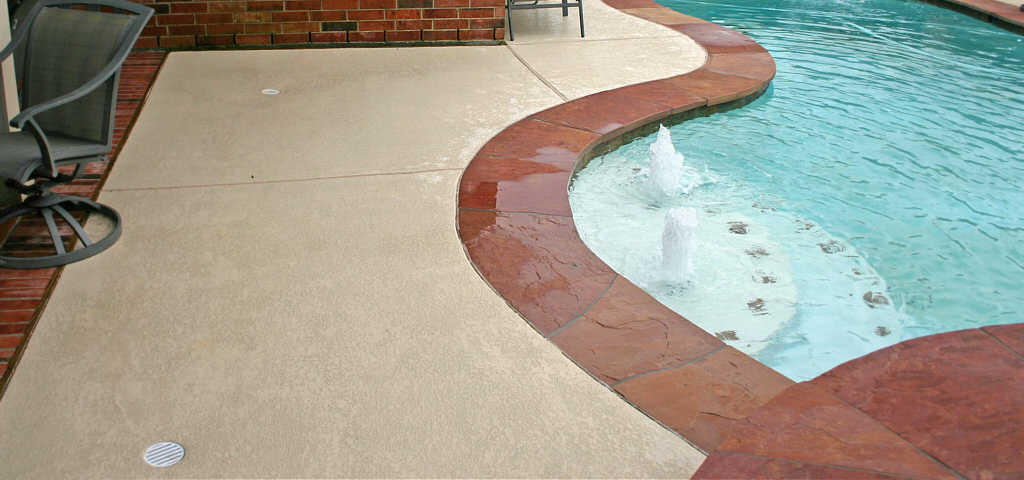 swimming pool decks - brushed concrete, pea gravel, spray deck